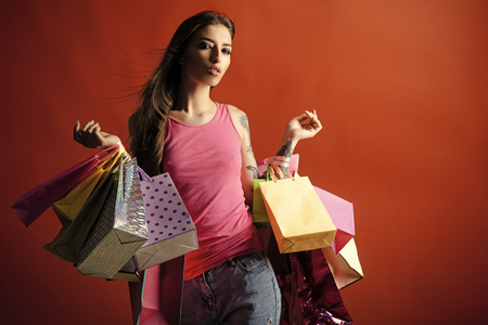 Happy woman. Woman shopper with shopping bags, purchase