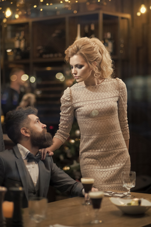 Love of a sexy young woman and bearded man in a suit.