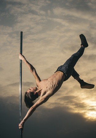 sport and healthy lifestyle. sport workout of dancer on pole in sunset Stok Fotoğraf
