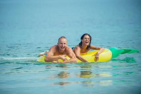 Sexy happy couple on Caribbean sea. sexy happy couple on summer vacation