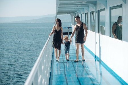 Love and trust as family values. Child with father and mother. Mother and father with son in sea trip. Family ship travel with kid on mothers or fathers day. Summer vacation of happy family.