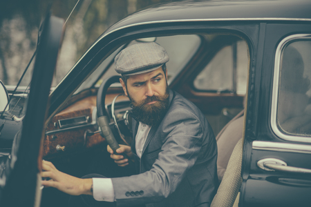 Escort man or security guard. escort service of bearded man in retro car
