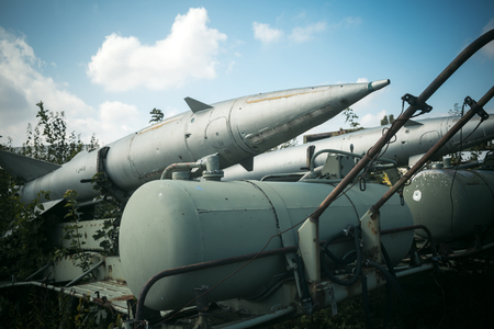 Air forces, aircraft, history, progress, development. Textured grunge old rocket launcher, blue sky background. Old rocket launcher in museum of aviation or garbage dump, recycling center.