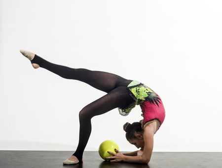 games of gymnast girl with ball. olympic games concept