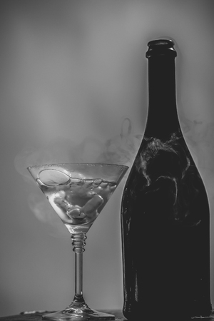 Bottle and goblet on pink Stock Photo