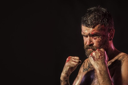 Fashion model Man fece close up. Face Man wiht happy emotion. Man in fight position with blood paint on face, fists Stock Photo