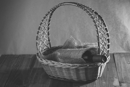 Basket with bottle of wine Stock Photo - 102200677