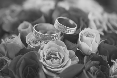 Rose bouquet and rings Stock Photo