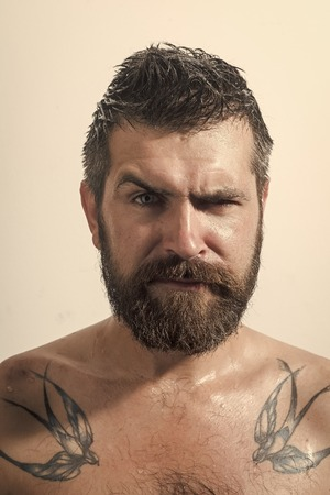 Mens heals body care. Man with long beard and mustache.