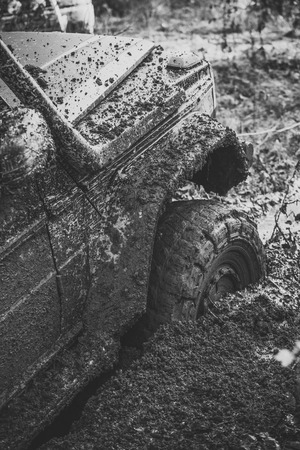 Fragment of car stuck in dirt, close up. Stock Photo - 102219214