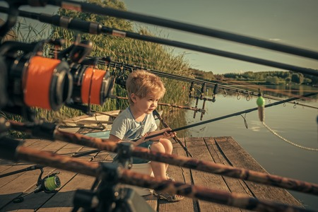 Summer vacation of little boy fishing