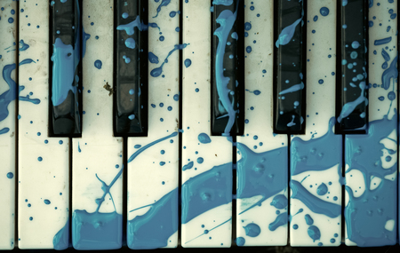 piano keyboard with a painted stain Stok Fotoğraf