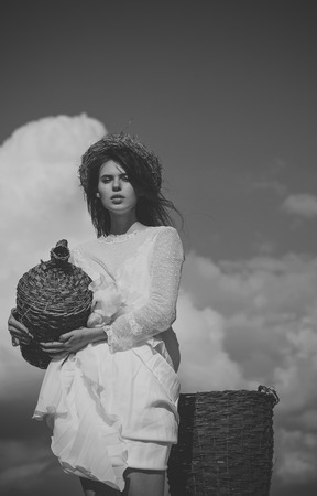 Women face skin care. Portrait women face in your advertisnent. Girl with wicker bottle and harvest basket Фото со стока - 102163091