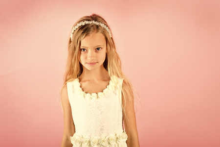 Little girl in fashionable dress, prom. Child girl in stylish glamour dress, elegance. Fashion model on pink background, beauty. Look, hairdresser, makeup. Fashion and beauty, little princess. Kids playing - happy game. Stok Fotoğraf