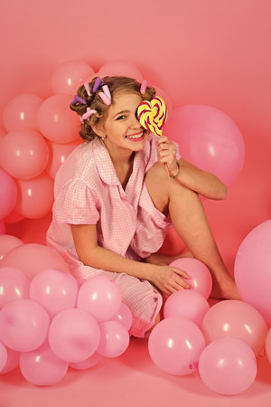 Little girl with candy lollipop. Stockfoto