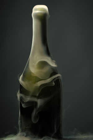 Champagne bottle with smoke