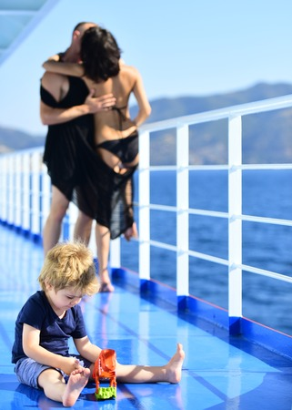 Summer vacation of happy family. Love and trust as family values. Mother and father with son in sea trip.Child play with toys at father and mother. Family travel with kid on mothers or fathers day.