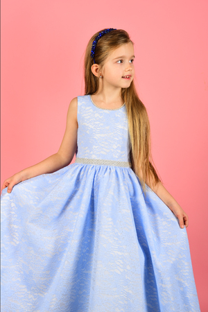 little girl model, wedding, fashion concept - girl dressed in blue and blue dress smiling