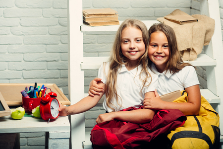 lesson with two happy children. lesson at school with girls sitting together. Stock Photo