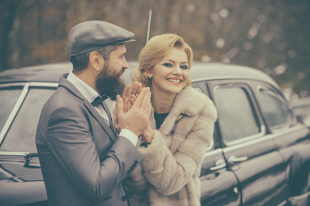 Retro couple at classy vintage car with happy face