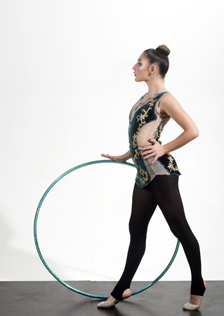 Sport success and health. Fitness and dieting of girl gymnast. Woman with gymnastic ring. Workout sports activities in gym of flexible girl. Woman train acrobatics with hoop in sportswear.