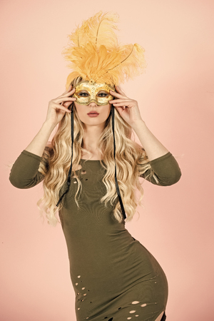 Happy woman. Woman with long blond hair in carnival mask.