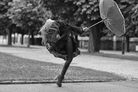 Happy woman. Young girl with red umbrella