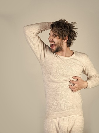 Mens heals body care. Man with disheveled hair in underwear. Фото со стока
