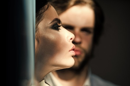 Prelude - couple in love. Woman face profile with blurred man on background Stock Photo