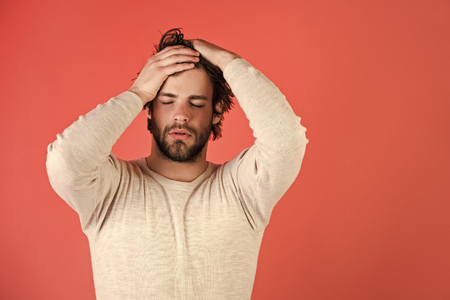 Mens heals body care. Sleepy man with beard on red background.