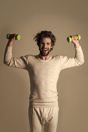 Mens heals body care. Sportsman, man on grey background.