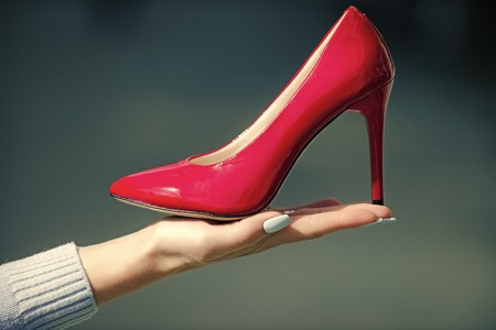 glamour shoe red color leather on female hand