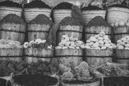 Multicolored pumice stones dry algae in wooden buckets