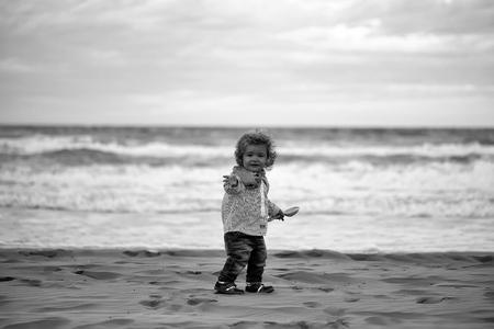 Childhood. Cute baby boy on beach 写真素材