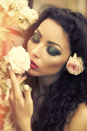 Female Face. Issues affecting girls. Portrait of attractive woman with flower in hair Reklamní fotografie - 102284379