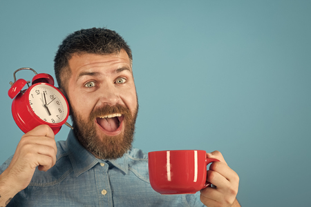 Mens heals care. Happy man. Red mug with alarm, perfect morning, copy space