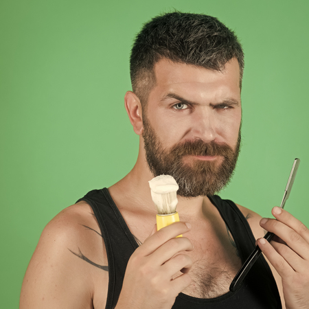 Mens heals body care. Haircut of bearded man, archaism.
