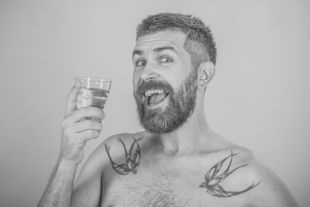 Mens heals body care. Hipster drink clean healthy water with happy face, refreshing.
