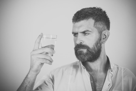 Mens heals body care. Hipster drink clean healthy water, refreshing.