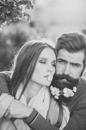 Prelude - couple in love. Girl and man with flowers on beard