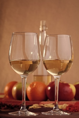 Pair glasses with bottle and fruits Standard-Bild - 102389480