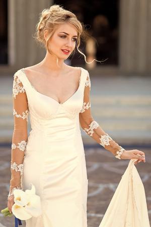 Sensual sexy woman. Woman face beauty. Pretty bride in white dress