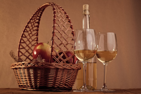 Basket with glasses and bottle of wine