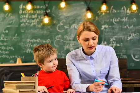 Desire to help should be in the tutor by nature, Worry student have a problem with mathematics, Good tutors are often communication masters, Happy teacher in classroom,