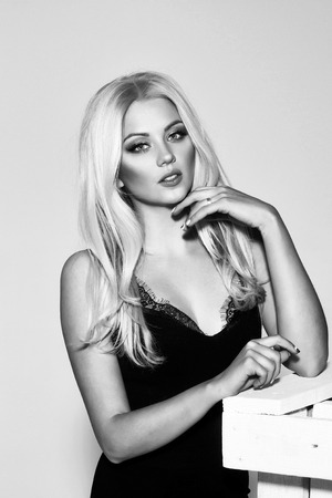 Sexy woman. pretty platinum blonde girl in black