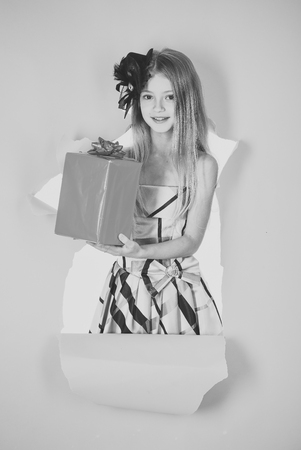 Kids face skin care. Portrait girl face in your advertisnent. Birthday and christmas. birthday present box for black friday