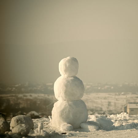 Business plan. christmas snowman made of white snow in winter