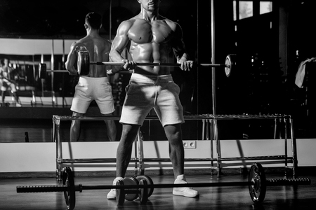 Mens heals body care. muscular man with barbell.