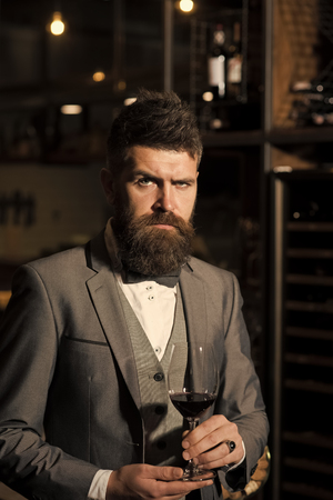 Barber shop. Hair style. perfect wine. wine glass in hands of serious bearded man in formal suit.