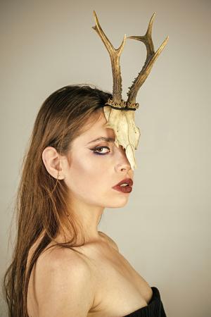 dark fantasy creature elf on halloween in skull woman with makeup